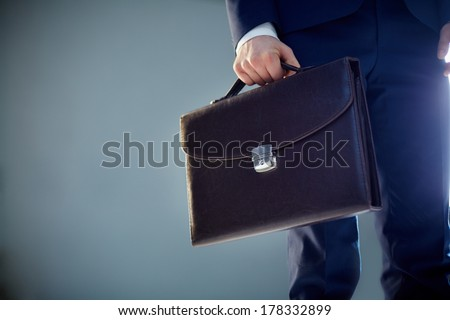 Isolated image of a businessman carrying a briefcase  - stock photo
