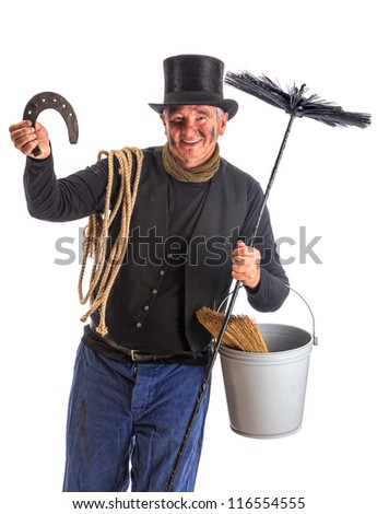 Isolated image of a chimney sweep wishing good fortune with a horseshoe - stock photo