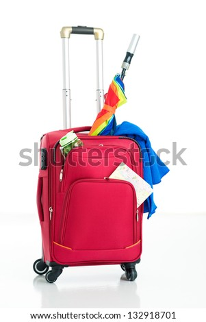 Isolated image of a crammed red suitcase - stock photo