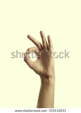 Isolated image of a hand with a gesture symbolizing the consent-ok - stock photo