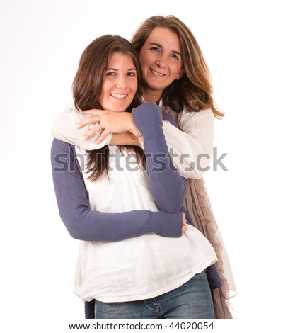 Isolated image of a mother and a daughter in a happy embrace - stock photo