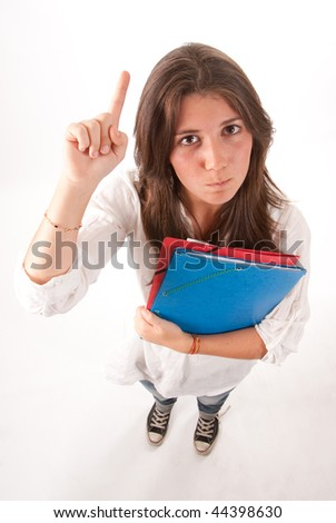 Isolated image of an angry young girl holding some folders raising her hand - stock photo