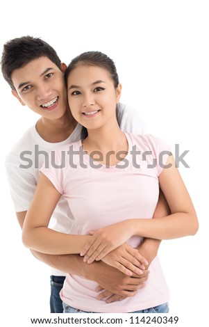 Isolated image of an embracing young couple - stock photo