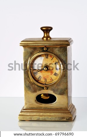 Isolated image of antique clock on white - stock photo