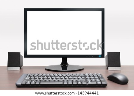 Isolated image of desktop computer with blank monitor - stock photo