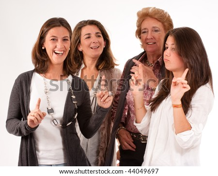 Isolated image of four women of different generations laughing together - stock photo