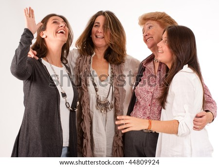 Isolated image of four women of different generations laughing together