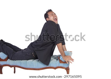 Isolated image of Funny Hispanic Man Posing on Chair - stock photo