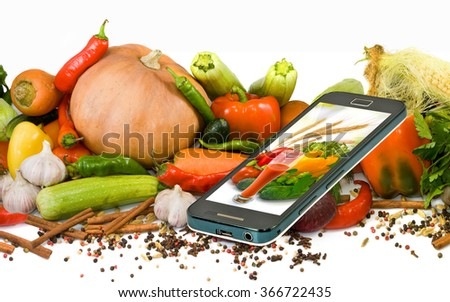 Isolated image of many vegetables and a mobile phone