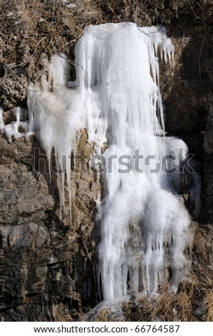 Isolated image of natural frozen waterfall - stock photo