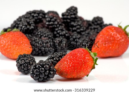 Isolated image of ripe blackberry and strawberry closeup - stock photo