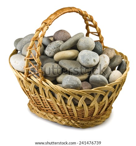 Isolated image of stones in the basket - stock photo