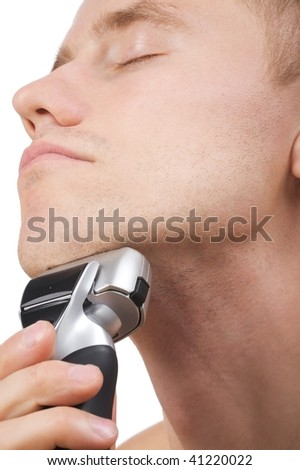 Isolated image young man a shaving electro razor - stock photo