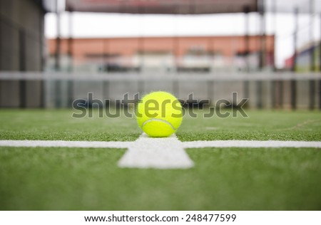 Isolated in court paddle tennis ball with short depth of field - stock photo