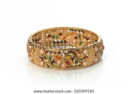 Isolated Indian golden bracelet with intricate craftsmanship. - stock photo