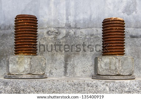 isolated industrial nuts and bolts - stock photo