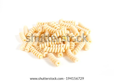 isolated italian pasta radiatore on white background - stock photo