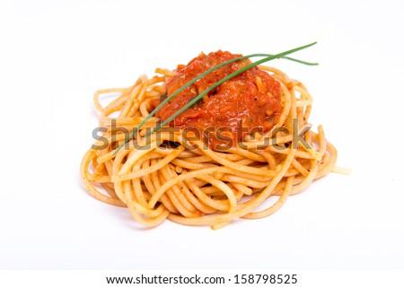 Isolated Italian spaghetti with tomato sauce  - stock photo