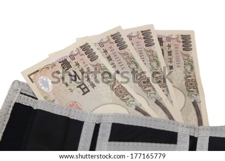 isolated 10000 japanese yen notes in a wallet