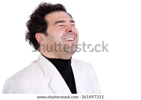Isolated jovial middle-aged man with stubble and curly hair expressing spontaneous laughter - stock photo