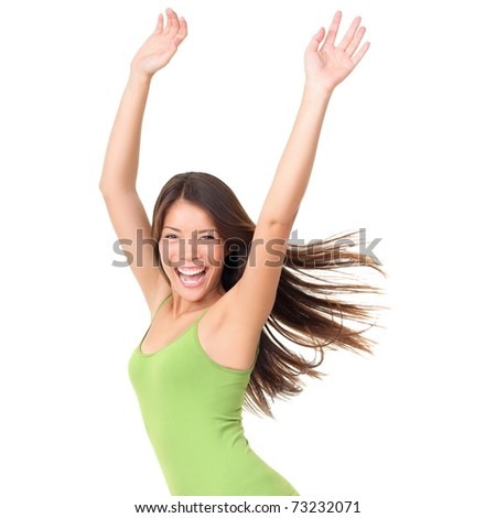 Isolated joyful carefree happy portrait of a young woman isolated on white background waist up. Beautiful Caucasian Asian multiracial female model in green tank top - stock photo