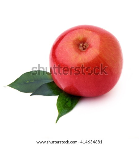 Isolated juicy ripe apple with green leaves. One red juicy ripe apple fruits isolated on white background with clipping path. - stock photo