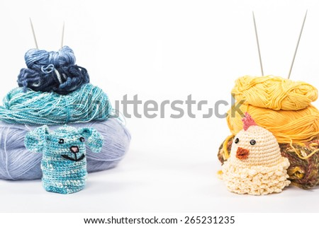 isolated knitting toy rabbit and chicken on a background of thread - stock photo