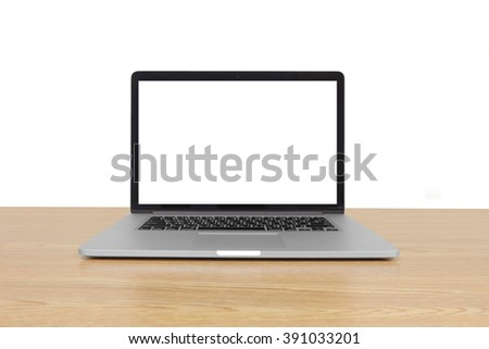 isolated laptop with blank space on wooden table