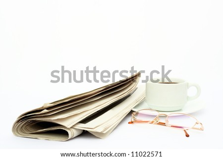 isolated laying news paper, glasses and cup coffee