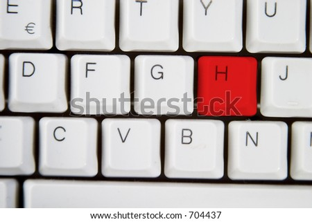 Isolated letter H on from a computer desktop keyboard highlighted in red