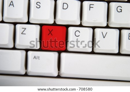 Isolated letter X on from a computer desktop keyboard highlighted in red
