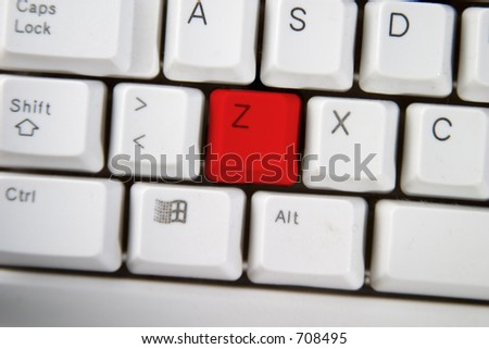 Isolated letter Z on from a computer desktop keyboard highlighted in red.