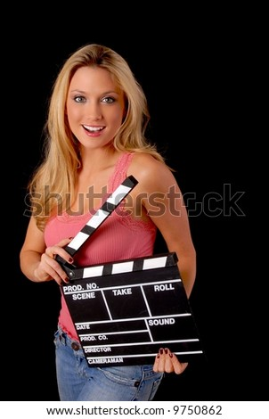 Isolated lovely and sexy young blond girl holding a cinema clapboard