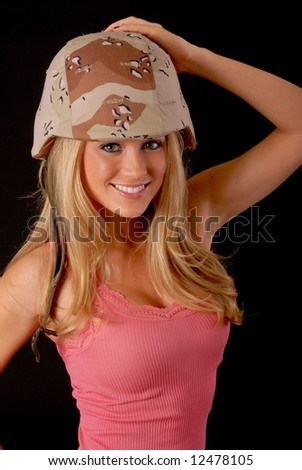 Isolated lovely and sexy young blond girl wearing a Army helmet - stock photo