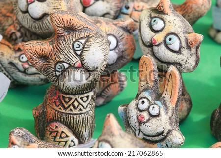 isolated macro several clay toys gift at the fair of folk crafts - stock photo