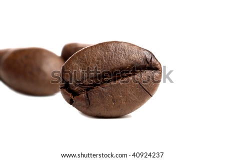 Isolated macro shot of two coffee beans