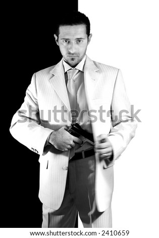 Isolated Mafia man pulling out his gun
