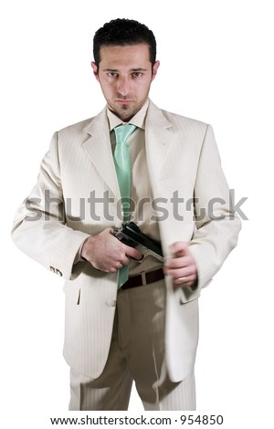Isolated Mafia man pulling out his gun - stock photo