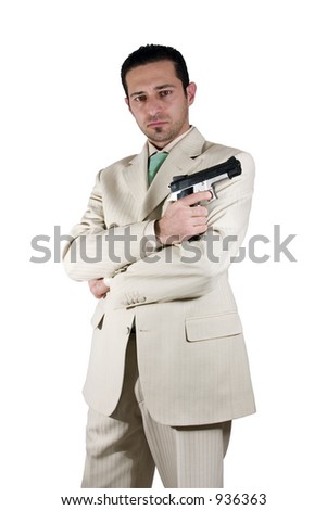 Isolated Mafia with arms crossed and a gunon hand - stock photo