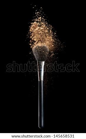 Isolated make-up powder with brush on black background - stock photo