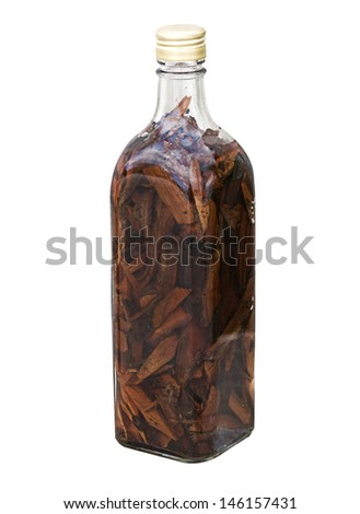Isolated Mamajuana Bottle, The Dominican Republic Home Made Aphrodisiac Drink  Made of Medicinal Roots - stock photo
