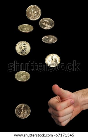 isolated man's hand and thrown golden dollar coin in different phases of spinning. The background is black. - stock photo
