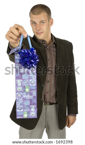 isolated man with gift (focus on gift)