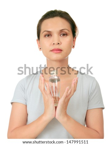 Isolated middle age asian woman with cosmetic cream - stock photo