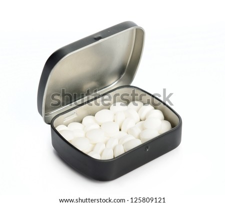 Isolated mint sweets in metal box against the white background - stock photo
