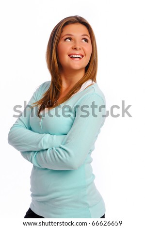 Isolated model crosses her arms and poses confidently - stock photo