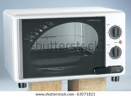 Isolated Modern Stainless Steel Electronic Microwave Oven - stock photo