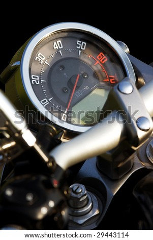 Isolated motorcycle speedometer close-up - stock photo