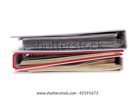 Isolated multicolored stack of binders with papers
