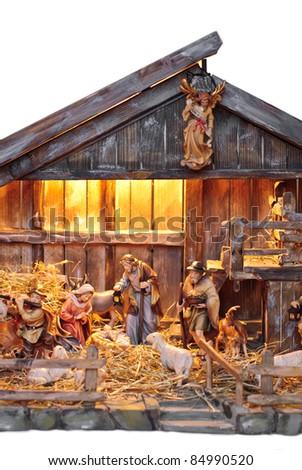 isolated nativity scene in a wooden creche - stock photo
